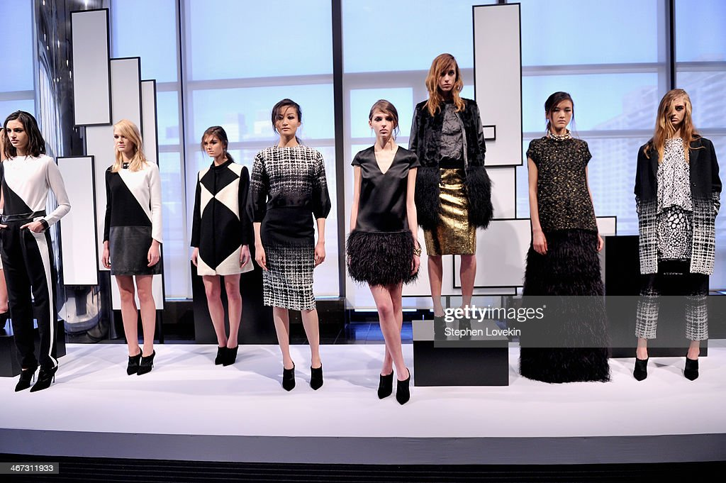 Models pose at the Raoul Prestentation during Mercedes-Benz Fashion Week Fall 2014 at Stanley H. Kaplan Penthouse at Lincoln Center on February 6, 2014 in New York City.