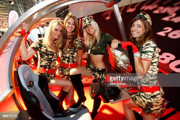 Models pose at the stand of Japanese technology corporate Fujitsu during the 'gamescom' Europe's biggest trade fair for interactive games and...
