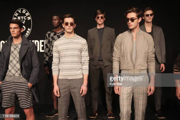 Models pose at the Todd Snyder presentation during Spring 2014 MercedesBenz Fashion Week at The Box at Lincoln Center on September 6 2013 in New York...