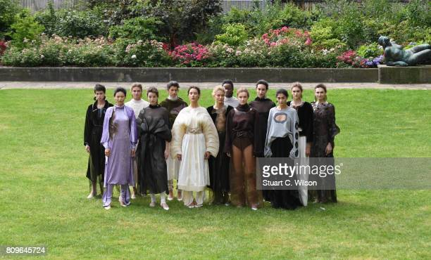 Models pose at the Vanessa Schindler presented by MercedesBenz ELLE defile during 'Der Berliner Mode Salon' Spring/Summer 2018 at Kronprinzenpalais...