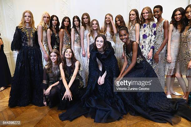 Models pose backstage after the Alberta Ferretti Limited Edition Fall/Winter 20162017 show as part of Paris Fashion Week on July 3 2016 in Paris...