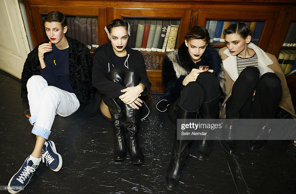 Models pose backstage ahead of Angelo Marani show during Milan Fashion Week Womenswear Autumn/Winter 2014 on February 19, 2014 in Milan, Italy