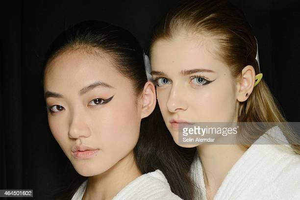 Models pose backstage ahead of the Anteprima show during the Milan Fashion Week Autumn/Winter 2015 on February 26 2015 in Milan Italy