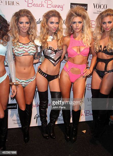Models pose backstage at the Beach Bunny Featuring The Blonds show during MercedesBenz Fashion Week Swim 2015 at Cabana Grande at The Raleigh on July...