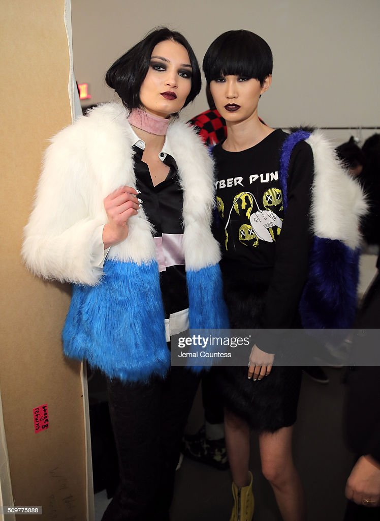 Models pose backstage at the iiJin Fall 2016 fashion show during New York Fashion Week at Pier 59 on February 12, 2016 in New York City.