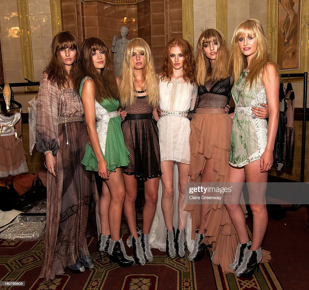 Models pose backstage at the Kristian Aadnevik show during London Fashion Week SS14 at The Royal Horseguards on September 15, 2013 in London, England.