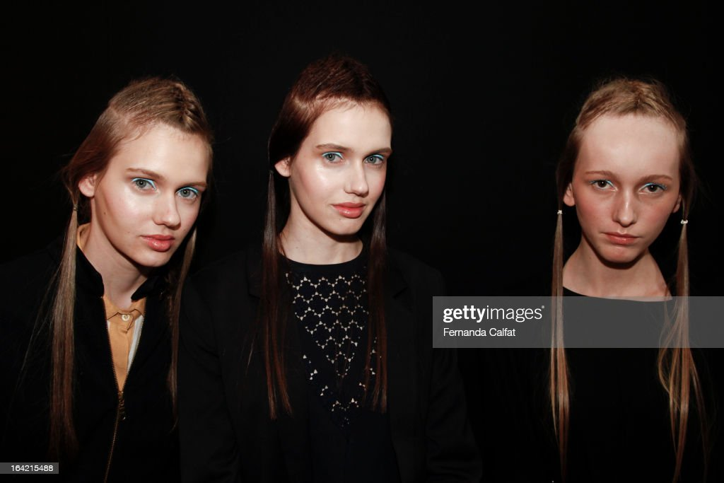 Models pose backstage at the Triton show during Sao Paulo Fashion Week Summer 2013/2014 on March 20, 2013 in Sao Paulo, Brazil.