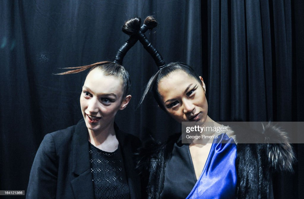 Models pose backstage at the World MasterCard Fashion Week Fall 2013 Collection at David Pecaut Square on March 19, 2013 in Toronto, Canada.