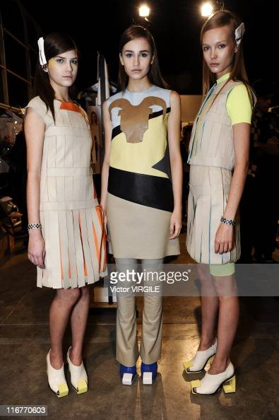 Models pose backstage during the Gloria Coelho show of the Ready to Wear Spring/Summer 2012 collection as part of the Sao Paulo Fashion Week on June...