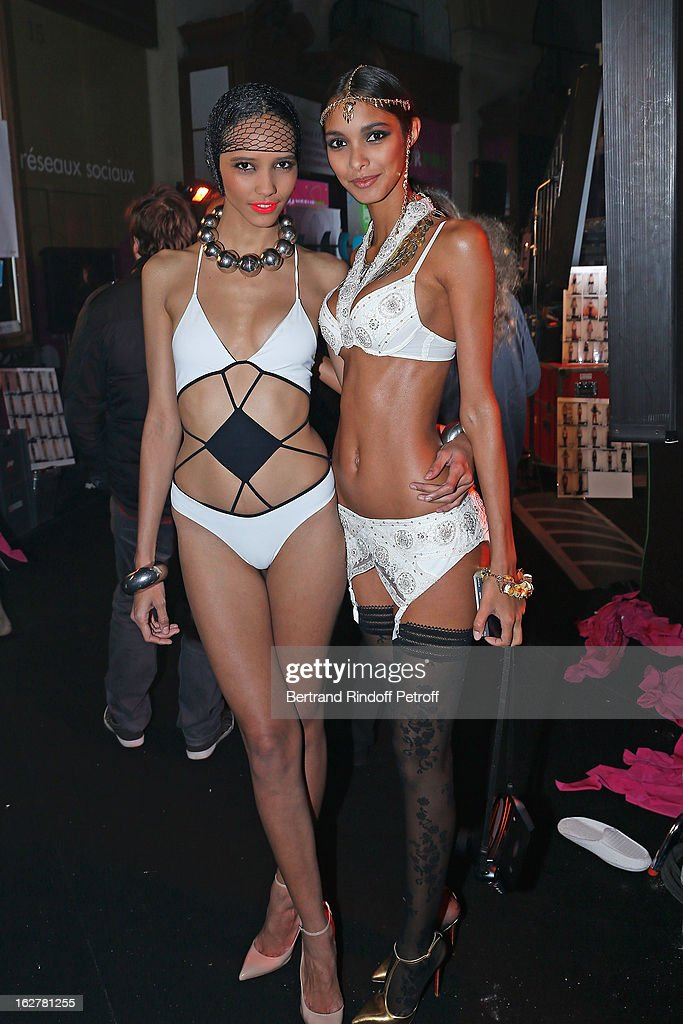 Models pose backstage following the Etam Live Show Lingerie at Bourse du Commerce on February 26, 2013 in Paris, France.