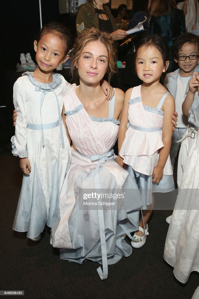 Models pose backstage for the Vicky Zhang fashion show during New York Fashion Week: The Shows at Gallery 1, Skylight Clarkson Sq on September 13, 2017 in New York City.