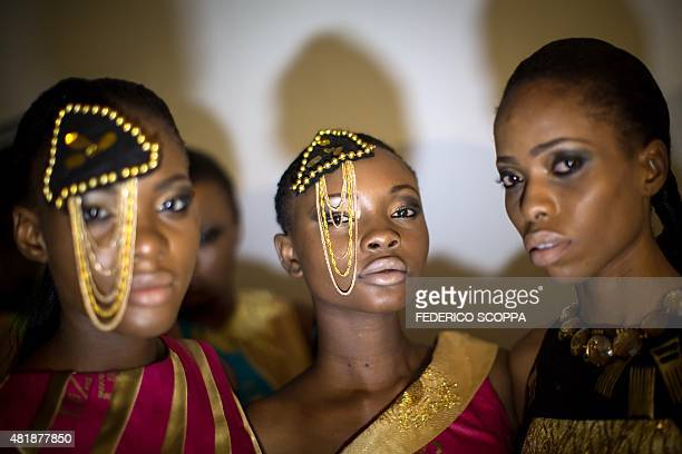 Models pose backstage on July 24 2015 during the Kinshasa fashion week in Kinshasa AFP PHOTO / FEDERICO SCOPPA