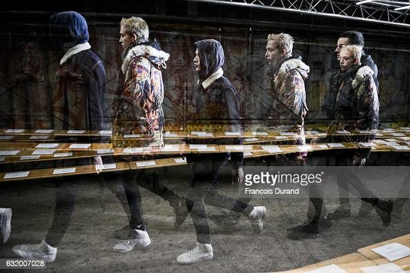 Models pose Backstage prior the Icosae Menswear Fall/Winter 20172018 show as part of Paris Fashion Week on January 18 2017 in Paris France