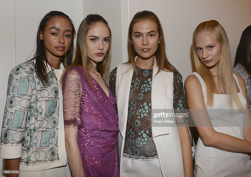 Models pose backstage wearing Douglas Hannant at the Douglas Hannant fashion show during Mercedes-Benz Fashion Week Spring 2014 on September 11, 2013 in New York City.