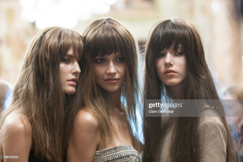 Models pose backstage wearing Frontcover Cosmetics at the Kristian Aadnevik show during London Fashion Week SS14 at The Royal Horseguards on September 15, 2013 in London, England.