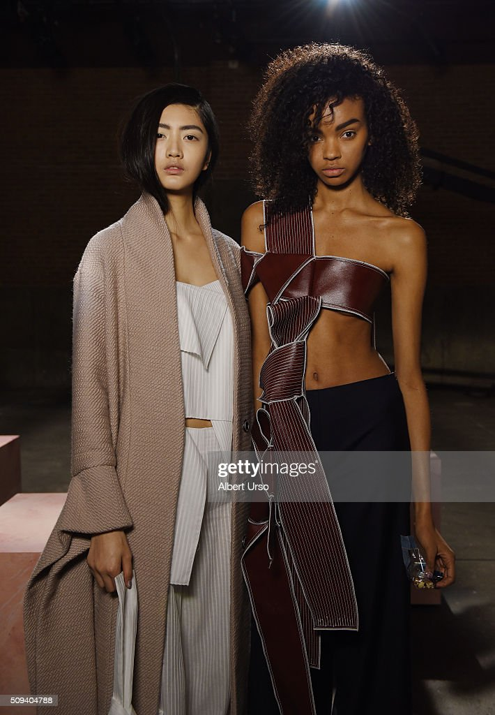 Models pose before the start of the Claudia Li presentation during New York Fashion Week Women's Fall/Winter 2016 at ArtBeam on February 10, 2016 in New York City.