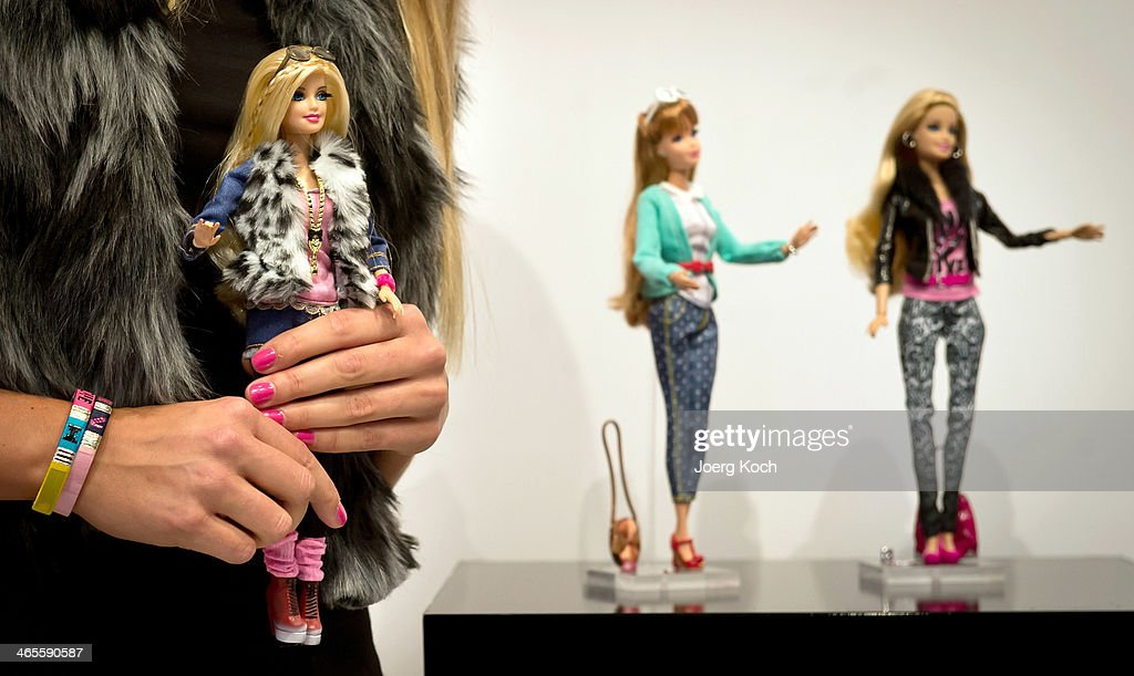 Models pose during a Barbie Runwayshow for the Barbie Collection 2014 at the Press-Preview of the Nuremberg International Toy Fair 2014 on January 28, 2014 in Nuremberg, Germany. The Barbie Collection 2014 was presented by Designer Guido Maria Kretschmer. The Nuremberg International Toy Fair 2014 is the worlds biggest toy fair and is opendend to visitors from January 29th to February 3rd.