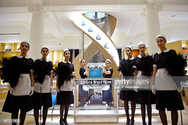 Models pose during a photocall to launch the Louis Vuitton Townhouse at Selfridges on November 7 2013 in London England The first Louis Vuitton...