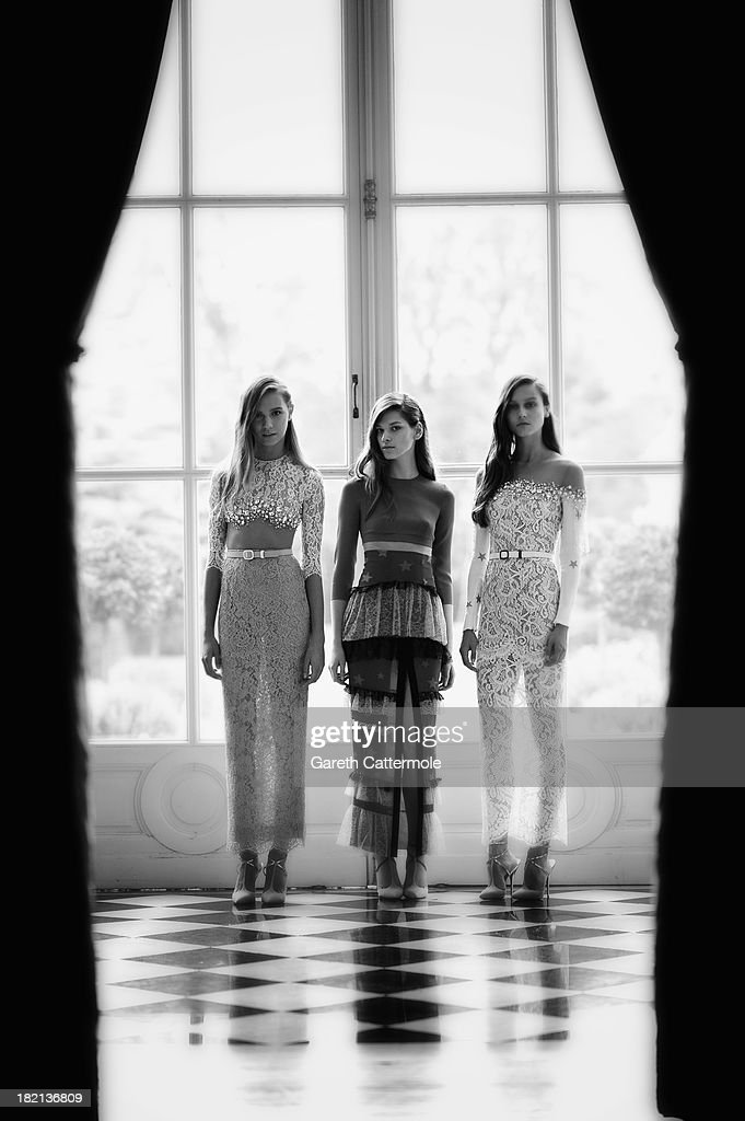 Models pose during the Alessandra Rich presentation at the British Ambassador's residence as part of Paris Fashion Week Womenswear Spring/Summer 2014 on September 28, 2013 in Paris, France.
