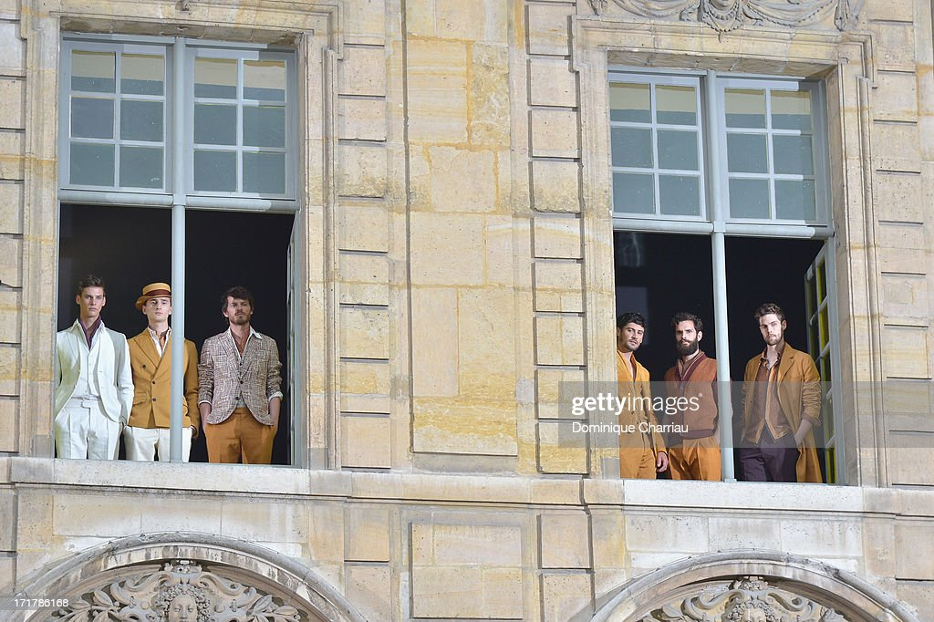 Models pose during the Berluti Menswear Spring/Summer 2014 show as part of the Paris Fashion Week on June 28, 2013 in Paris, France.