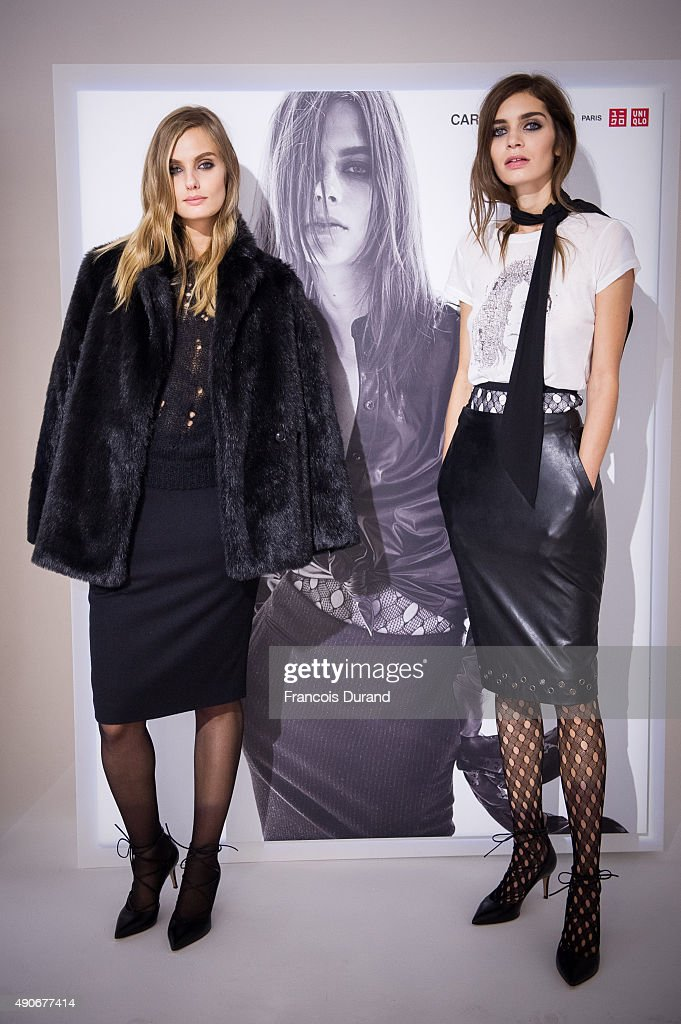Models pose during the Carine Roitfeld Collection For Uniqlo Presentation as part of the Paris Fashion Week Womenswear Spring/Summer 2016 on...