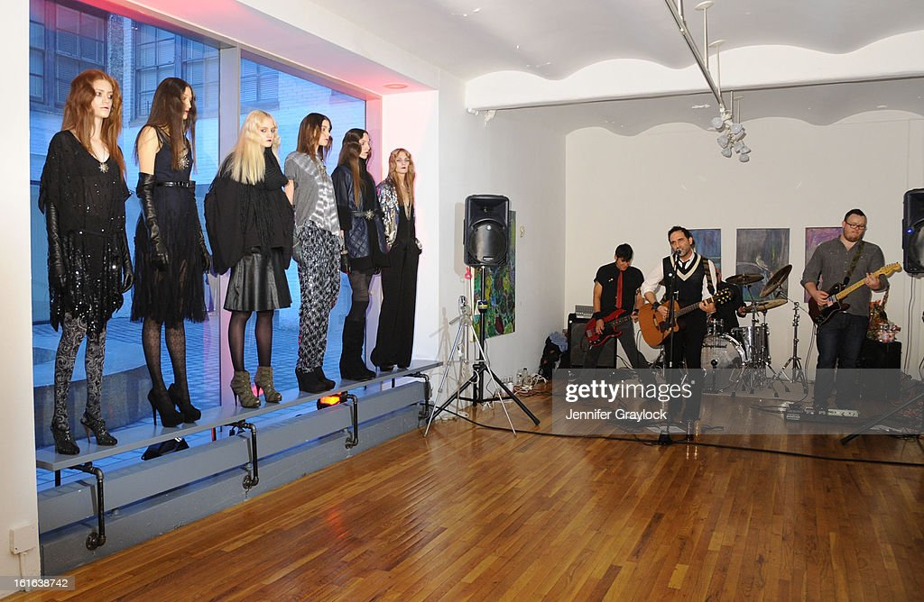 Models pose during the Diego Binetti Fall 2013 Mercedes-Benz Fashion Presentation held at Westbeth Gallery on February 13, 2013 in New York City.