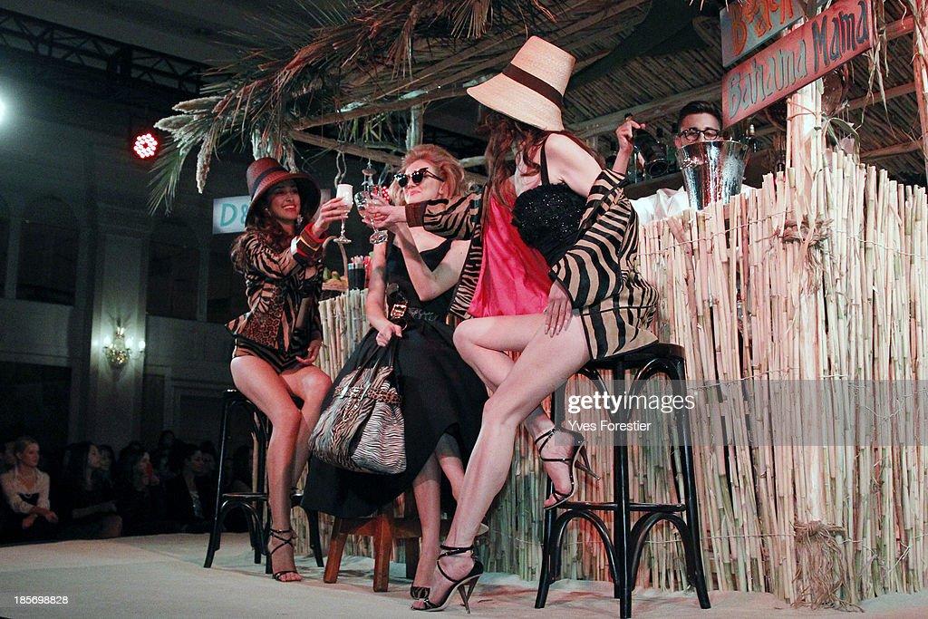 Models pose during the Dsquared2 fashion show at Hotel International Tashkent on October 23, 2013 in Tashkent, Uzbekistan.