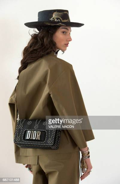 Models pose during the first cruise collection by Maria Grazia Chiuri for Dior show in the Upper Las Virgenes Canyon Calabasas California on May 11...