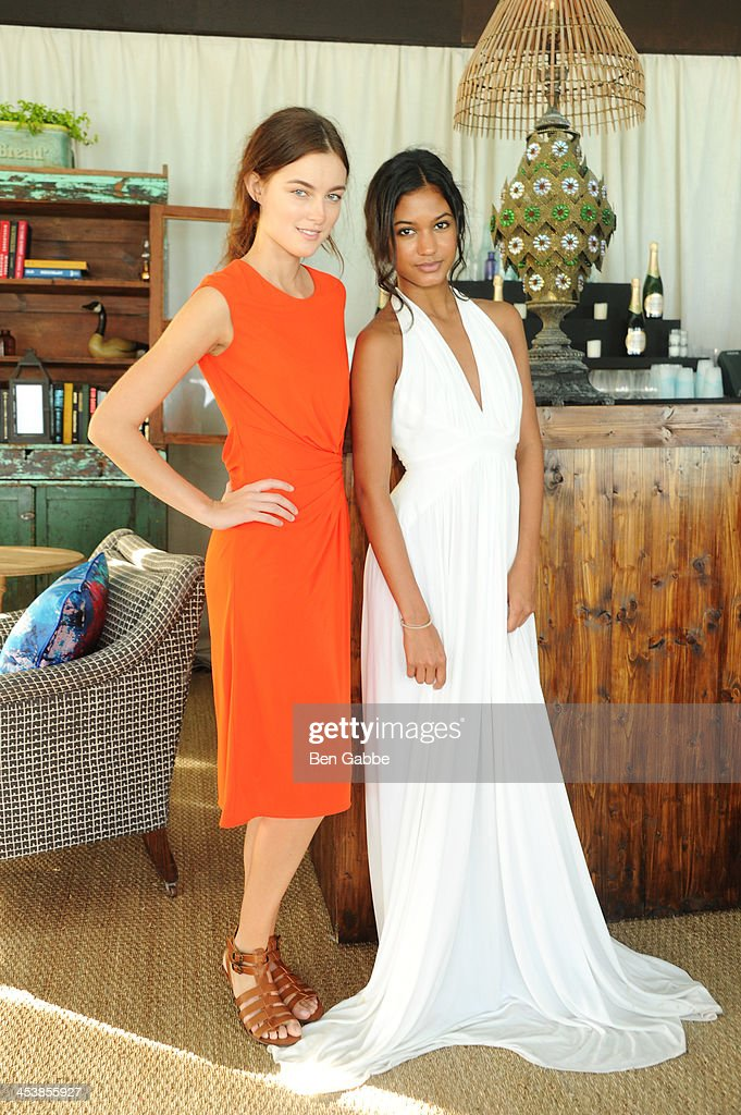Models pose during the ISSA London lunch celebrating British fashion and fashion illustration at the Tent at Soho Beach House on December 5, 2013 in Miami Beach, Florida.