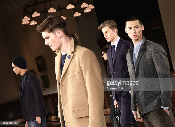 Models pose during the Jack Spade Presentation during MercedesBenz Fashion Week Fall 2014 at New York Public Library on February 5 2014 in New York...
