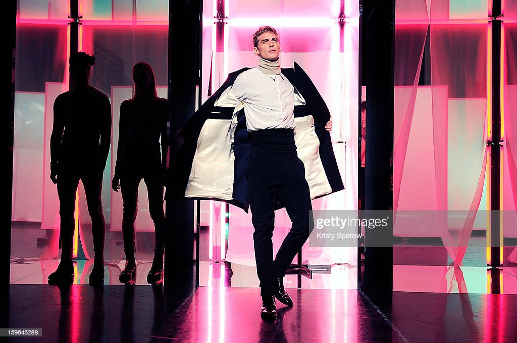 Models pose during the Jean Paul Gaultier Menswear Autumn / Winter 2013/14 show as part of Paris Fashion Week on January 17, 2013 in Paris, France.