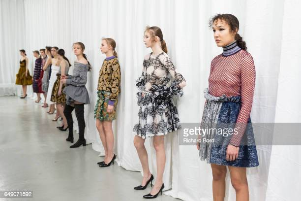Models pose during the Jourden presentation at Palais de Tokyo during Paris Fashion Week Womenswear Fall/Winter 2017/2018 on March 7 2017 in Paris...