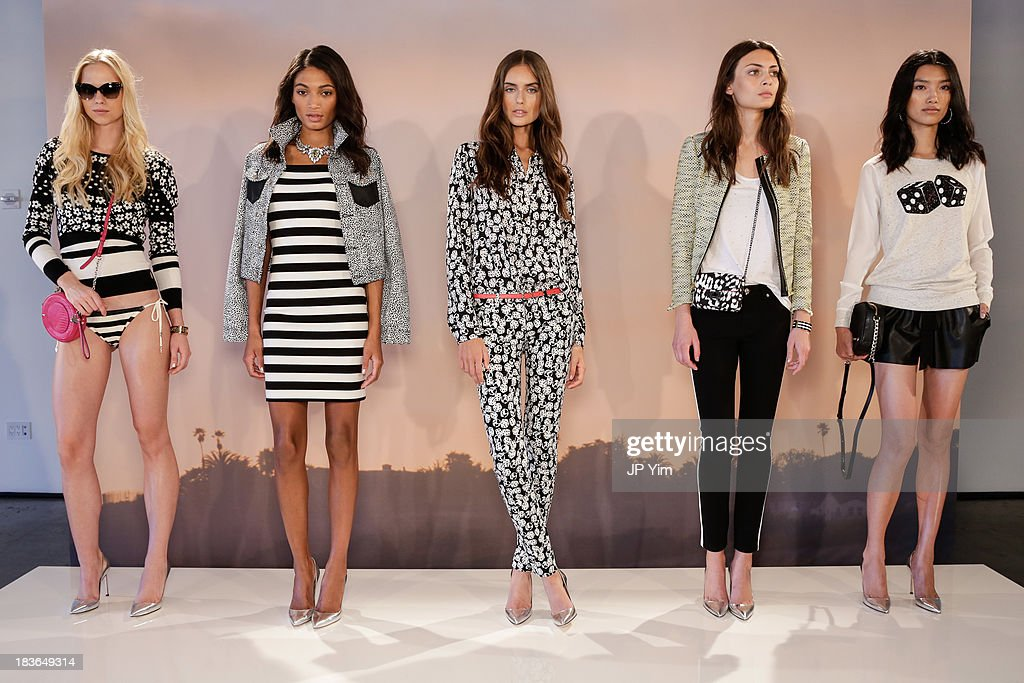 Models pose during the Juicy Couture spring 2014 presentation at Milk Studios on October 8, 2013 in New York City.