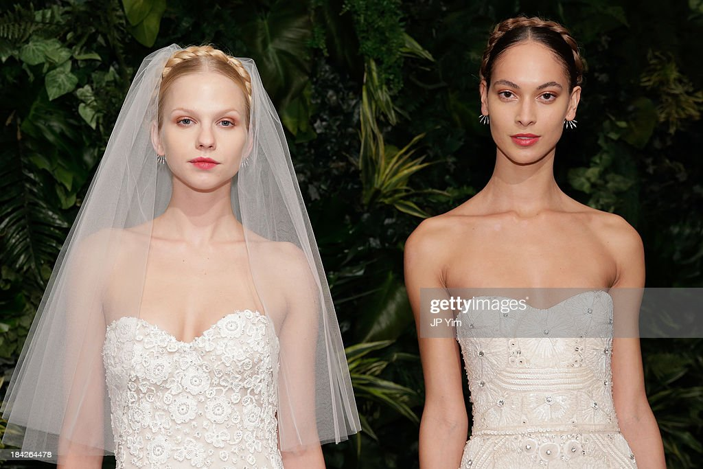 Models pose during the Naeem Khan Fall/Winter 2014 Bridal Collection presentation and reception on October 12, 2013 in New York City.