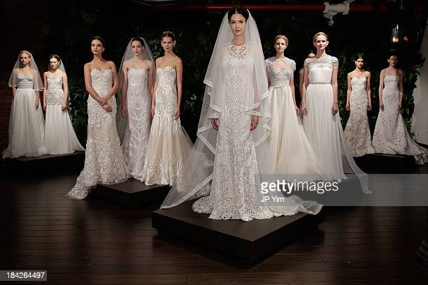 Models pose during the Naeem Khan Fall/Winter 2014 Bridal Collection presentation and reception on October 12 2013 in New York City