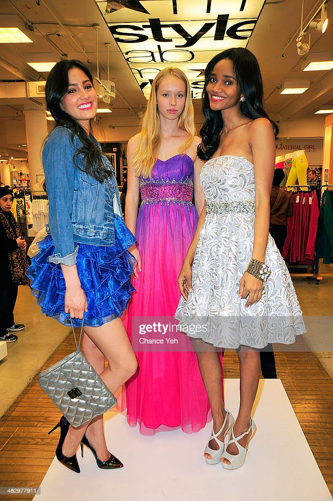 Models pose during the prom wear presentation for Mack Wild's visit at Macy's Herald Square on April 5, 2014 in New York City.