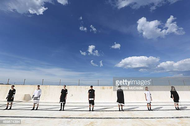 Models pose during the Ten Pieces show at MercedesBenz Fashion Week Australia 2015 at Bondi Icebergs on April 16 2015 in Sydney Australia