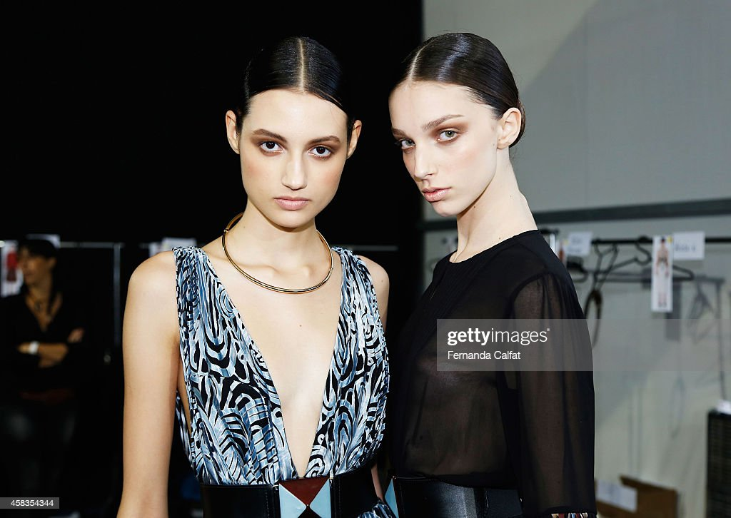 Models pose for a photo backstage at the Victor Dzenk fashion show during Sao Paulo Fashion Week Winter 2015 at Parque Candido Portinari on November...
