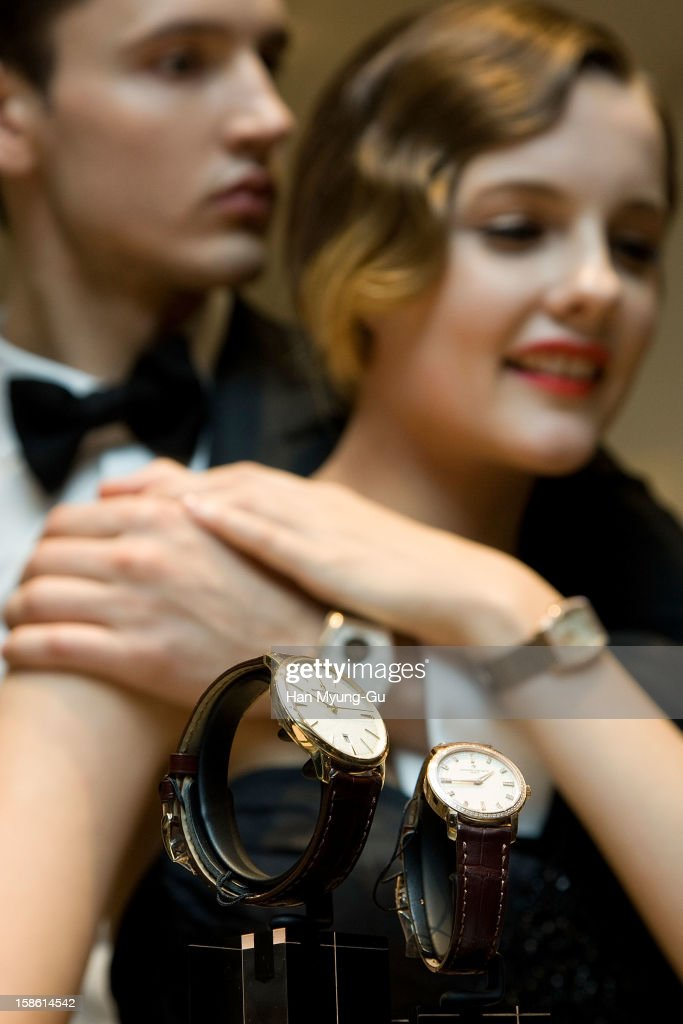 Models pose for media during the Malte tourbillon 100th anniversary celebration of luxury watch brand Vacheron Constantin at Hyundai Department Store on December 21, 2012 in Seoul, South Korea.