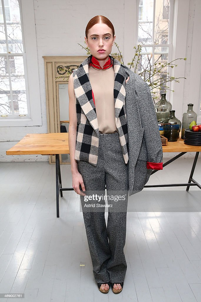 Models pose for photos at the Christine Alcalay presentation during Mercedes-Benz Fashion Week Fall 2014 on February 12, 2014 in New York City.