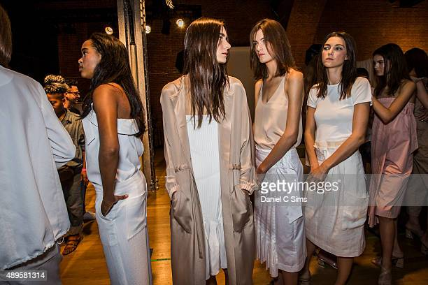 Models pose for photos backstage at the Tibi SS16 show part of New York Fashion Week Spring/Summer 2016 on September 12 2015 in New York City