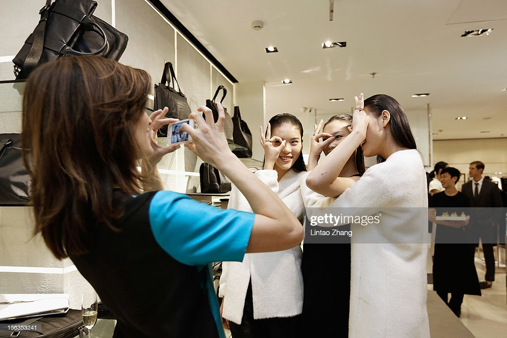 Models pose for picture during the Fall 2012 Presentation at the Calvin Klein store in Oriental Plaza on November 13, 2012 in Beijing, China.