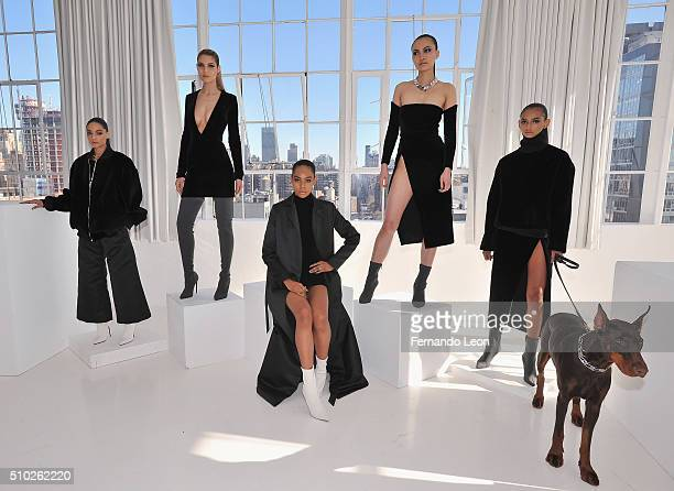 Models pose for pictures at the Laquan Smith Presentation at Jack Studios during Fall 2016 New York Fashion Week on February 14 2016 in New York City