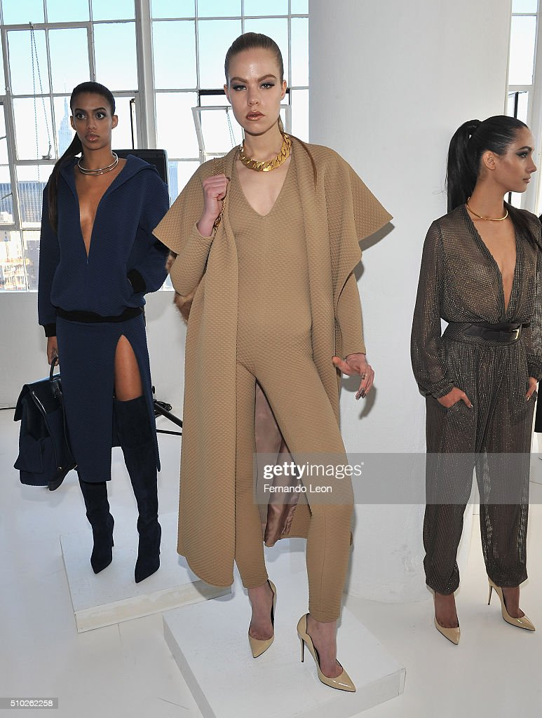 Models pose for pictures at the Laquan Smith Presentation at Jack Studios during Fall 2016 New York Fashion Week on February 14, 2016 in New York City.