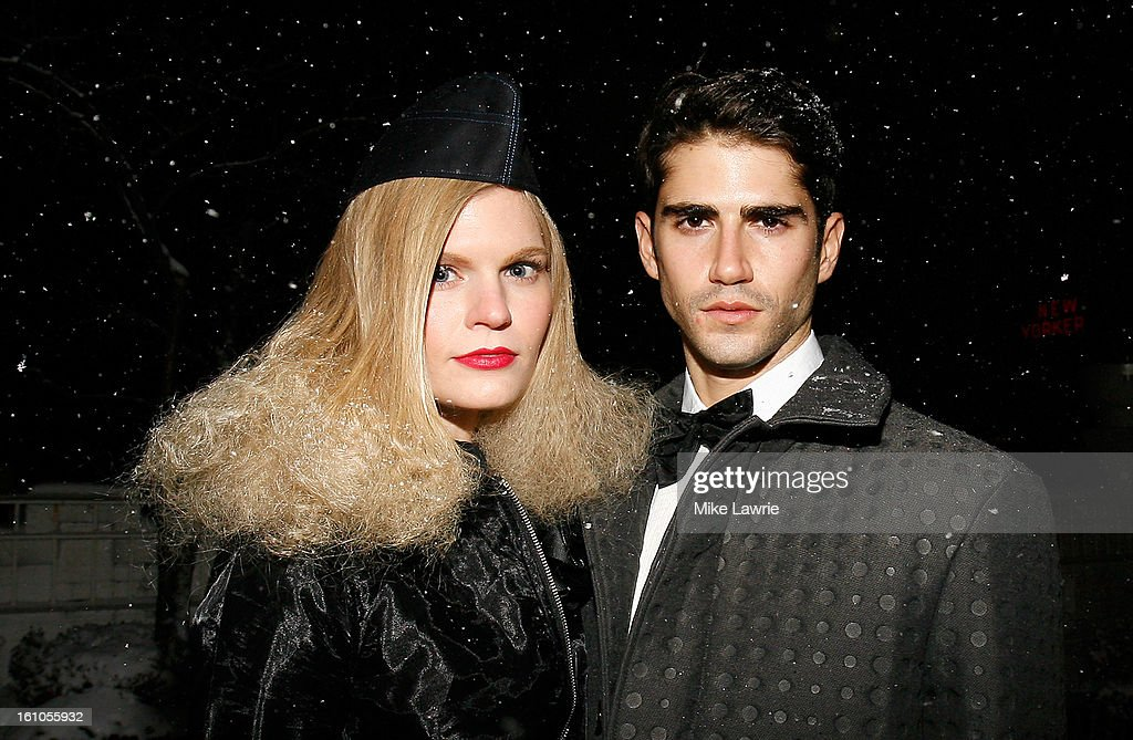 Models pose in the snow backstage at the Marlon Gobel fall 2013 fashion show during MercedesBenz Fashion Week at Studio 450 on February 8 2013 in New...