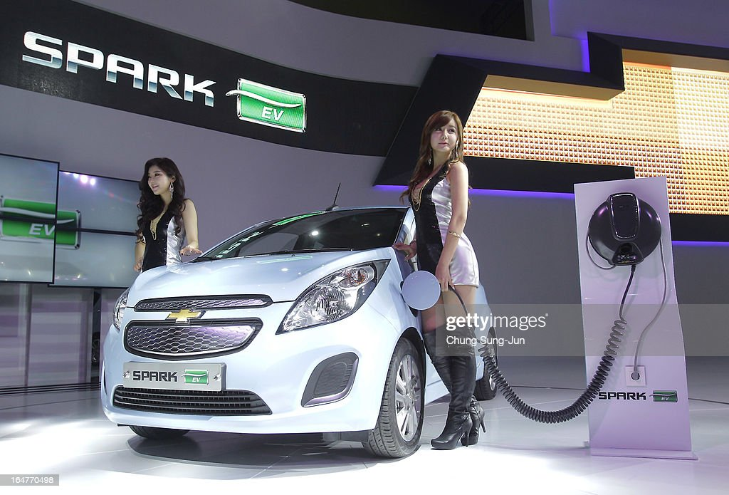 Models pose next to a Chevrolet Spark EV at the Seoul Motor Show 2013 on March 28, 2013 in Goyang, South Korea. The Seoul Motor Show 2013 will be held in March 29-April 7, featuring state-of-the-art technologies and concept cars from global automakers. The show is its ninth since the first one was held in 1995. About 384 companies from 14 countries, including auto parts manufacturers and tire makers, will set up booths to showcase trends in their respective industries, and to promote their latest products during the show.