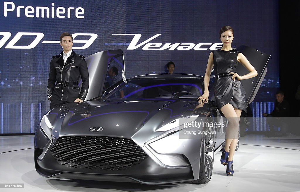 Models pose next to a Hyundai HND-9 Venace at the Seoul Motor Show 2013 on March 28, 2013 in Goyang, South Korea. The Seoul Motor Show 2013 will be held in March 29-April 7, featuring state-of-the-art technologies and concept cars from global automakers. The show is its ninth since the first one was held in 1995. About 384 companies from 14 countries, including auto parts manufacturers and tire makers, will set up booths to showcase trends in their respective industries, and to promote their latest products during the show.