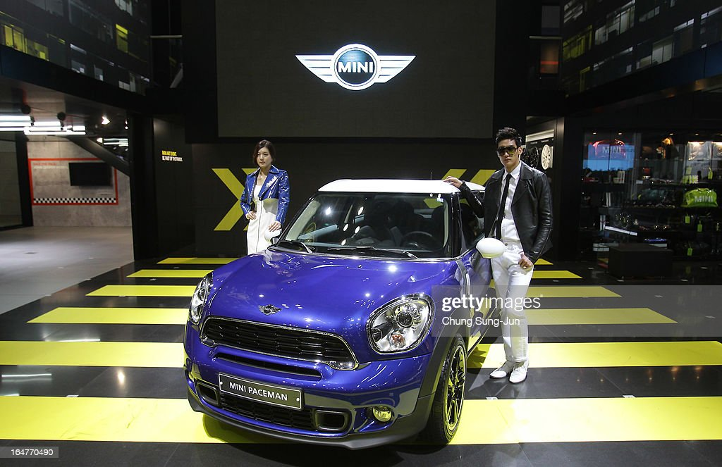 Models pose next to a MINI Paceman at the Seoul Motor Show 2013 on March 28, 2013 in Goyang, South Korea. The Seoul Motor Show 2013 will be held in March 29-April 7, featuring state-of-the-art technologies and concept cars from global automakers. The show is its ninth since the first one was held in 1995. About 384 companies from 14 countries, including auto parts manufacturers and tire makers, will set up booths to showcase trends in their respective industries, and to promote their latest products during the show.