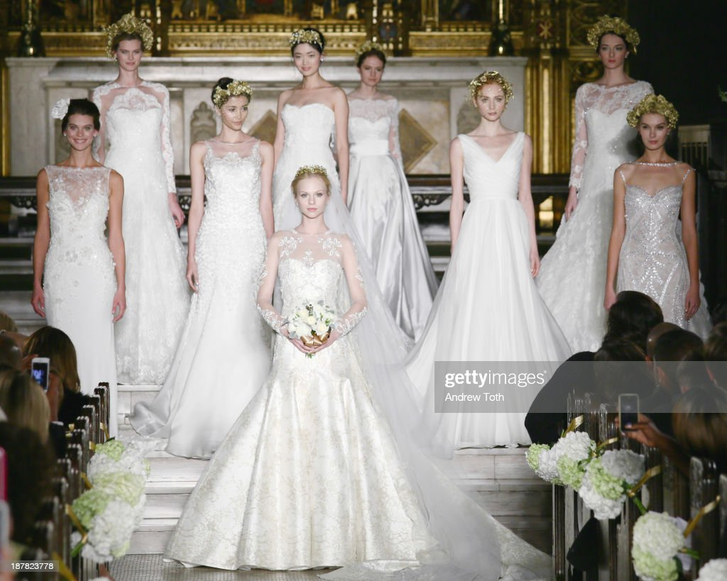 Models pose on the runway at the Atelier Pronovias 2014 Show at St. James Church on November 12, 2013 in New York City.