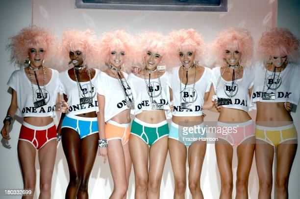 Models pose on the runway at the Betsey Johnson fashion show during MercedesBenz Fashion Week Spring 2014 at The Studio at Lincoln Center on...
